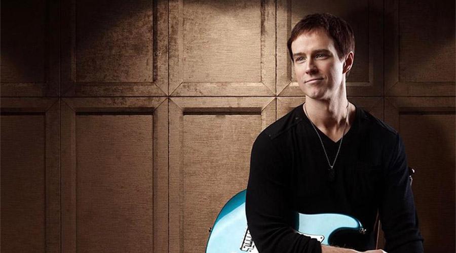 Michael Cavanaugh sitting with Guitar